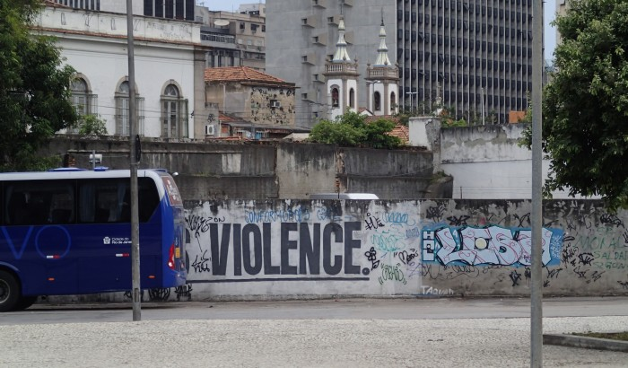 "Full sign was ""Money is Violence"" but I like ""Bus Violence."" It s rare to see murals in English."